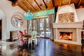 Mediterranean Print Dining Room With Large Firepalce Wood Ceiling Beams