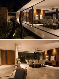 Glass Doors That Open The Interior To Garden Outside Creating Indoor Outdoor Spaces Are Found Throughout Home Like In Dining Room