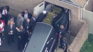 Muhammad Ali Makes Final Journey Home as Coffin is Taken to