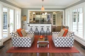 Sunroom Furniture Ideas With Crisscross Upholstery Sofa Four Pillows Rectangle Wooden Table On Red