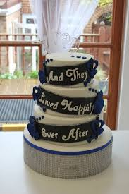"Royal blue black and white "" and they lived happily ever after"" wedding cake"