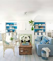 Living Room With Beach Flair Sea Blue Tones Single Fold Tiles On The Fireplace