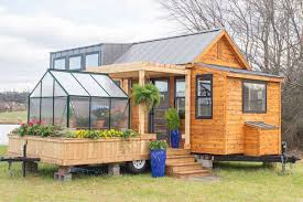 100 Tiny House Newsletter House Comes With A Greenhouse And Porch Curbed
