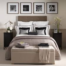 Chic Hotel Style Bedroom With Neutral Upholstered Bed And White Linen