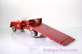 Tonka Ramp Hoist Flatbed And Wrecker Truck *sold* - Antique Toys For ... Amazoncom Peterbilt Truck With Flatbed Trailer And 2 Farm Tractors 116th Big Farm John Deere Ram 3500 Dually Skidloader 5th Red Race Car Hot Wheels Crashin Big Rig Blue Shop Express 1100 Germany 1957 Hmkt Antique Cast Iron Toy Flatbed Truck 116 Model 367 Farmall Wood Toy Plans Semi Youtube Ertl New Holland T7030 Tractor Lego City 60017 Walmartcom Antique Vintage Dinky Toys Supertoys Foden Chains Intertional Durastar 4400 Flat Bed Tow