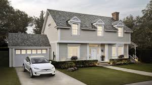 tesla begins taking orders for its solar energy roof tile systems