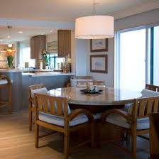 A Drum Lamp Shade On This Pendant Light Radiating Strong And Focussed Downward Over Dining Table As Well Illuminating The Room With Ambient