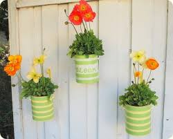 Old Tin Cans In A Variety Of Sizes Can Be Easily Made Into Planters With