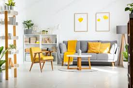 real photo of a scandi living room interior with gray and yellow photo by bialasiewicz on envato elements