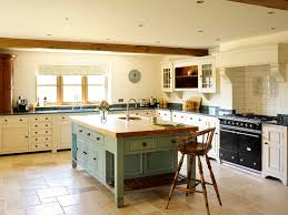 Cream Kitchen Cabinets With Dark Handles Green Granite Worktops Rustic And Wooden