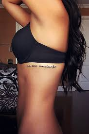 Phrase Tattoo Idea On The Side Rib Cage For Woman