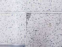 Close Up Of Terrazzo Tile Exhibiting Edge Spalling Cracked Agglomerated