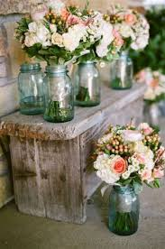 Rustic Wedding Decoration Ideas With Flowers And Blue Mason Jars