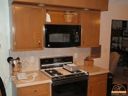 Above Kitchen Cabinet Decorative Accents by Retrofitting Kitchen For Over The Range Microwave