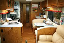 Lounge Of RV With A Pair Long Chairs Table Small Corner Preparing