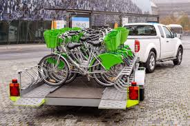 New Bicycles With Green Accessories Being Transported On A Trailer ...
