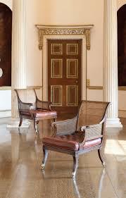 100 Regency House Furniture A PAIR OF REGENCY MAHOGANY AND EBONISED BERGERES I CIRCA I