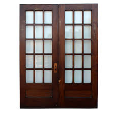 pair of salvaged 64 divided light doors with beveled glass