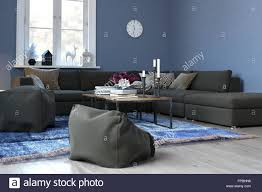 Cozy Blue Living Room With Sectional Sofa And Plush Bean Bag Chairs