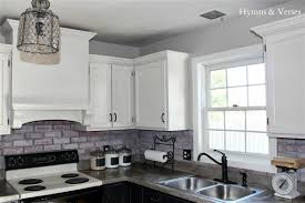 contemporary kitchen with white faux brick subway tile
