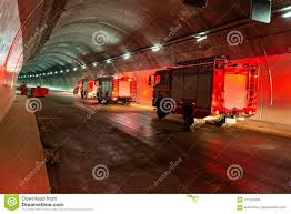 100 Fire Lights For Trucks Entering A Large Tunnel With Red Rescue Stock