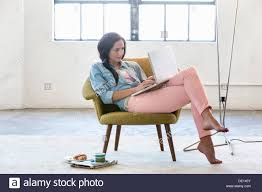 Woman Using Laptop In Armchair Stock Photo, Royalty Free Image ... Young Beautiful Woman Reading A Book In White Armchair Stock 1960s Woman Plopped Down In Armchair With Shoes Kicked Off Tired Woman In Armchair Photo Getty Images With Fashion Hairstyle And Red Sensual Smoking Black Image Bigstock Beautiful Business Sitting On 5265941 And Antique Picture 70th Birthday Cake Close Up Of Topp Flickr Using Laptop Royalty Free Pablo Picasso La Femme Au Fauteuil No 2 Nude Red 1932 Tate Sexy Sits 52786312
