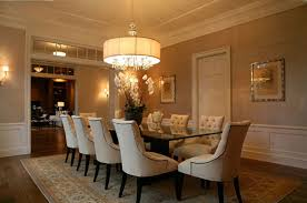 contemporary dining room design with round oversized chandeliers