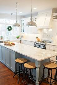 Industrial Pendants Over Blue Kitchen Island With Beadboard Trim White Granite Countertops