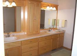 white bathroom cabinet with glass doors with victorian dark wood