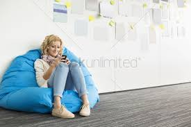 Smiling Businesswoman Using Mobile Phone On Beanbag Chair In ... Lumisource Andrew Contemporary Adjustable Office Chair Beanbag Interior Stock Photo Edit Now 1310080723 Details About Loungie Sofa 3 In 1 Ottoman Floor Pillow Linen Or Sherpa Fabric Businesswoman Using Laptop Bean Bag Chair Office Hot Item Mulfunction Lazybones Lazy Bean Bag Household Computer Cy300 Versa Table Lcious Grey Indoor Interstuhl Movy High Back Modern Executive Ideas For News Under The Hood Of 2017 Bohemian Softrock Living Super Study Jxsolo Bean Bag Desk Chair Not Available Anymore See Get Acquainted With Zanottas Italian Flair Indesignlive