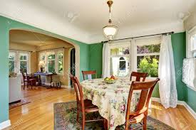 Traditional Dining Area With Wooden Table Set Open Floor Plan