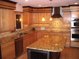 brown granite countertops with pendant light and wooden cabainet