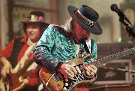 Stevie Ray Vaughan With Double Trouble Tommy Shannon Is In The Back