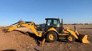 100 Permian Trucking Backhoe Emco OilField Basin Transportation Service