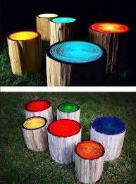 Logs Painted With Glow In The Dark Paint For Summer Parties