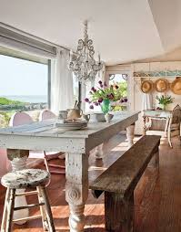 Coastal Dining Space In A Cottage Style Home With Rustic Farm Table