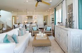 Coastal Living Room Beach Cottage Features Ceiling Fan Over White Slipcovered Sofa With