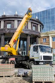 100 Truck Mounted Crane Mounted On A Building Construction Site Stock Photo
