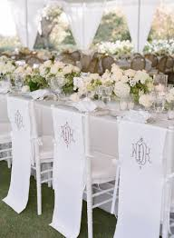 Reception Décor Photos - Monogram Chair Covers - Inside Weddings Chair Cover Hire In Liverpool Ozzy James Parties Events Linen Rentals Party Tent Buffalo Ny Ihambing Ang Pinakabagong Christmas Table Decor Set Big Cloth The Final Details Chair And Table Clothes Linens Custom Folding Covers 4ct Soft Gold Shantung Tablecloths Sashes Ivory Polyester Designer Home Amazoncom Europeanstyle Pastoral Tableclothchair Cover Cotton Hire Nottingham Elegance Weddings Tablecloths And For Sale Plaid Linens