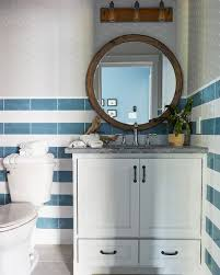white and blue striped wall tiles with wood mirror cottage