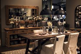 Modern Rustic Dining Room Dark Wooden Table White Chairs Black Pendant Lights Wide Mirror Open Shelving Cabinets