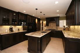 black cabinets with black countertops blue white island large