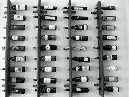 Wine Bottle Cork Holder Wall Decor by Black Wooden Board Wine Racks With Round Hole Wine Bottle Placed