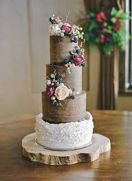 Brown Fall Wedding Cake With Sugared Berries And Flowers A Chocolate Ganache Rustic White Ruffled Frosting Cascading