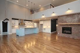 opening between kitchen and living room sleek black coffee table