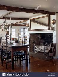 Wrought Iron Chandelier Above Wooden Table And Chairs In ...