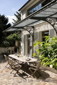 Gotta find a place to use the beautiful old wrought iron awning