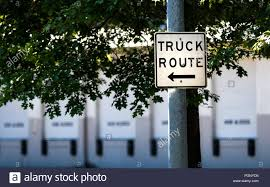 100 Truck Route Sign Route Sign On A Steel Post With Trees And Loading Docks In The