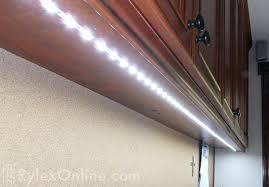 line voltage puck cabinet lighting vs low lights light