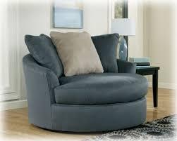 oversized swivel chair in ndigo finish by